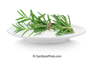 rosemary in plate on white background