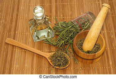 Rosemary product, Rosemary oil bottle and mortar with fresh and dried rosemary