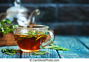 rosemary tea in cup and on a table