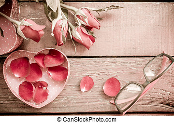 Roses and a hearts on wooden board, Valentines Day background Vintage Style.