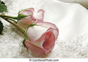 pink roses and white wedding gown