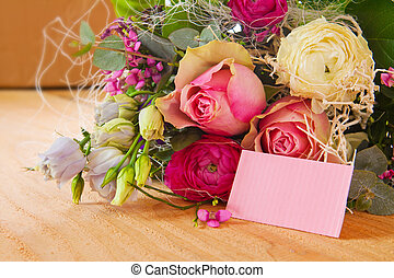 Roses bouquet and pink notice. Birthday card.