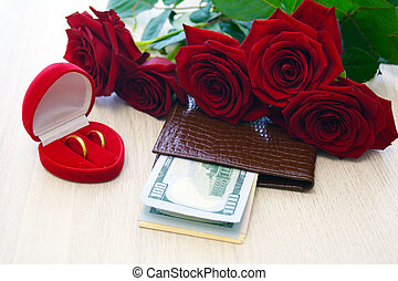 roses, box with two rings and dollars