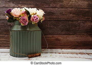 Roses Flower Bouquet in metal vase with space copy on wooden background