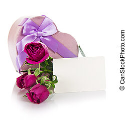 Roses, gift heart with ribbon and empty card