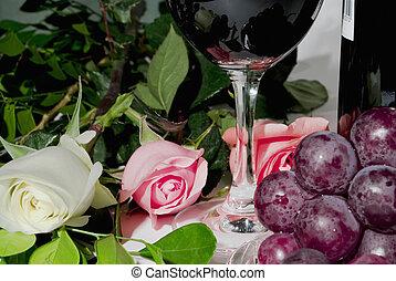 still life - Roses, grapes and wine still life close-up