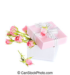 Roses in a gift box with a bow. - Gift box and roses....