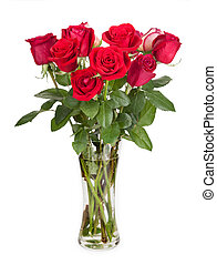 Roses in a glass vase isolated on white background