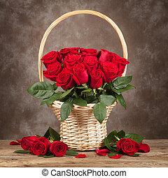 Roses in vase on brown wooden background