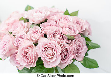 Roses lilac and pastel colors. Bright bouquet in metal bucket. concept of flower shop.