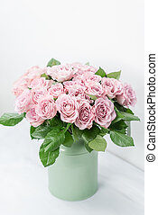 Roses lilac and pastel colors. Bright bouquet in metal bucket. concept of flower shop. vertical photo