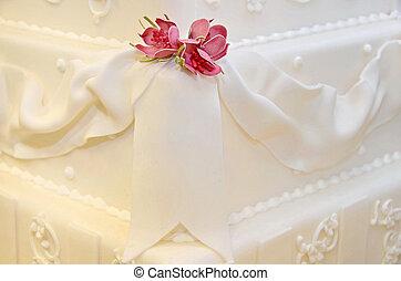 Dainty roses on corner of wedding cake.