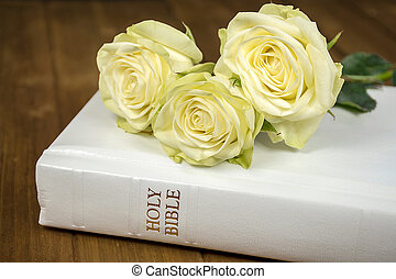 roses on white Bible