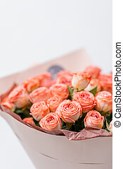 Roses peach and orange pastel colors. Bright bouquet in metal bucket. concept of flower shop.