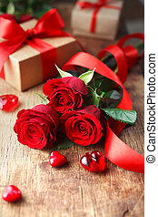 Roses with red ribbon and a hearts on wooden board, Valentines Day background, wedding day