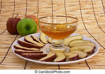 Rosh hashana - Different varieties of apple and honey. ...