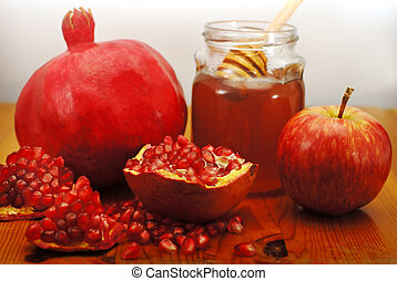 Rosh Hashana Traditional Food - Pomegranate with seeds,...