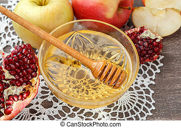 Rosh Hashanah concept, honey, apple, pomegranate