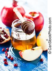 Rosh hashanah (jewish holiday) concept: honey, apple and...