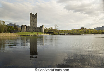 Ross castle and his reflection in Lough lake. Castle is located near city of Killarney in Ireland.
