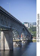 The Ross Island Bridge spans the Willamette River in Portland, Oregon.