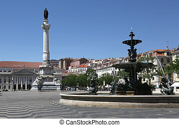 Rossio square in Lisbon Portugal with a statue and a ...