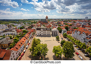 Aerial cityscape image of Rostock, Germany during sunny summer day.