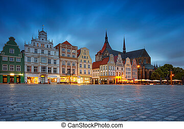Cityscape image of Rostock, Germany during twilight blue hour.