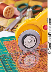 Rotary cutter cuts fabric on the a with a ruler