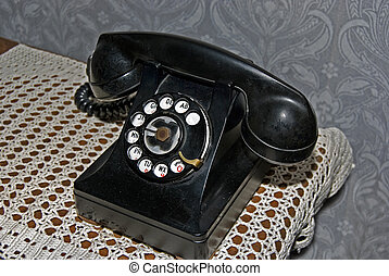 Rotary Dial - Old-fashioned phone on lace doily.