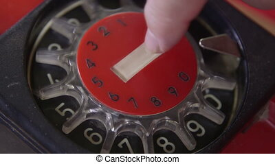 Rotary dial telephone - Dialing number on an antique rotary...