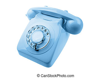 Rotary dial telephone on plain background
