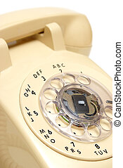 Rotary Phone - A closeup shot of a traditional rotary phone.