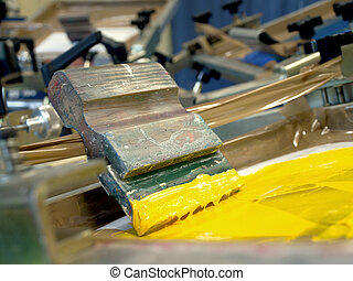yellow screen printing ink and squeegee