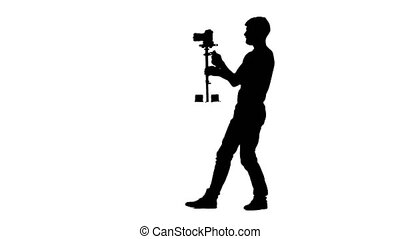 The man at the time of the shooting turns 180 degrees the camera installation Steadicam. Silhouette isolated on a white background