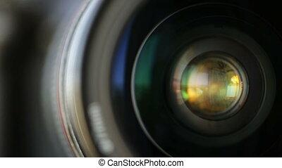 Rotate the camera lens horizontally. Closeup. - Rotate the...