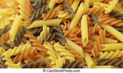 Rotated uncooked Italian macaroni pasta. - Loopable...