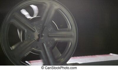 Rotating 16 mm film reel
