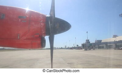 rotating aircraft engine propeller at background of airport