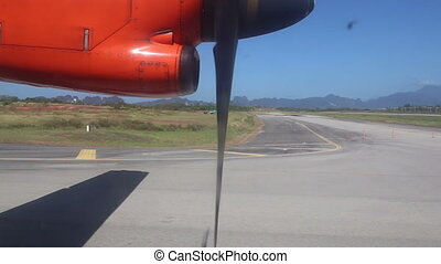 rotating aircraft engine propeller on runway