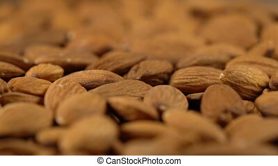rotating background of almonds, seamless loopable