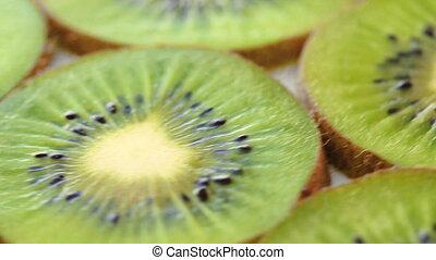 Rotating background of green kiwifruit - Footage of fresh...