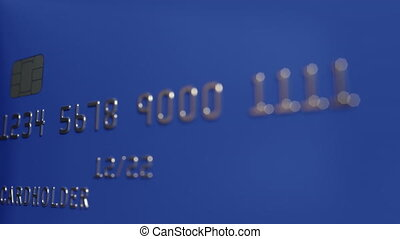 Close-up shot of turning blue credit cards