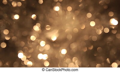 Rotating bokeh from golden tinsel. Christmas and new year background.