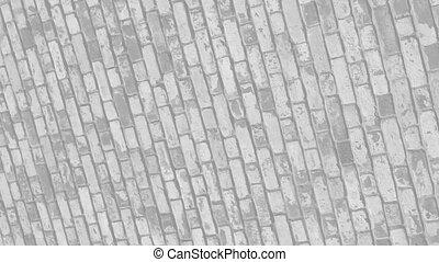 Rotating brick wall - Rotating clay brick and mortar wall in...