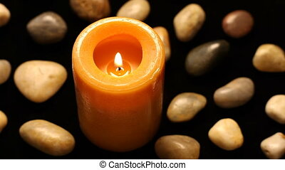Rotating candle and rocks