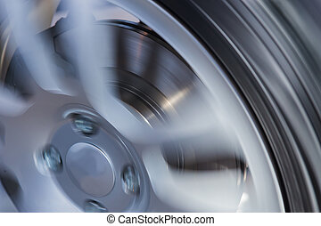 car wheel and brake disc close up - rotating car wheel and ...
