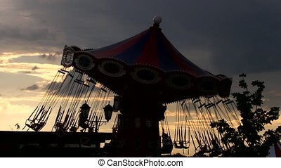 Rotating Carousel - silhouette against sunset