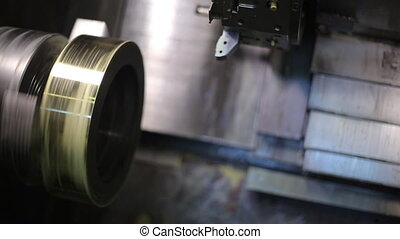 Rotating circular metal blank in a milling machine with CNC, closeup.