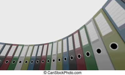 Rotating colored office binders. Good for reports and presentations. 4K seamless loopable clip, shallow focus